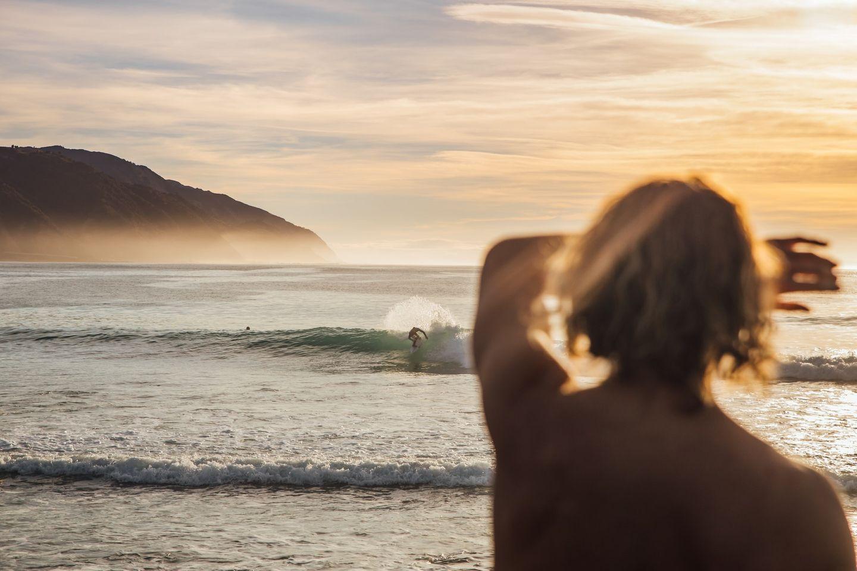 Work & Traveller beim Sonnenuntergang in Neuseeland