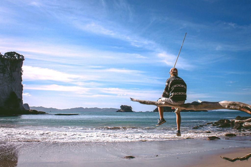 Work & Traveller am Strand in Neuseeland